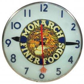 0019: Monarch Fine Foods electric light-up clock w/bubb