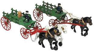 Toy Wagons (2), both horse drawn cast iron stake bed,