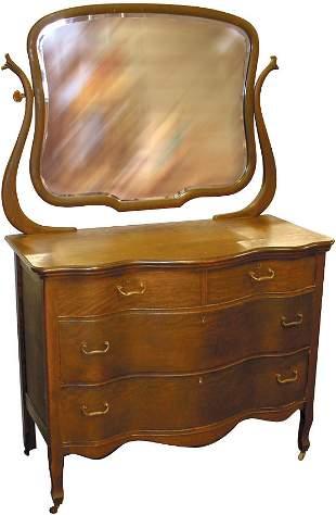 Oak dresser w/beveled wishbone mirror & serpentine