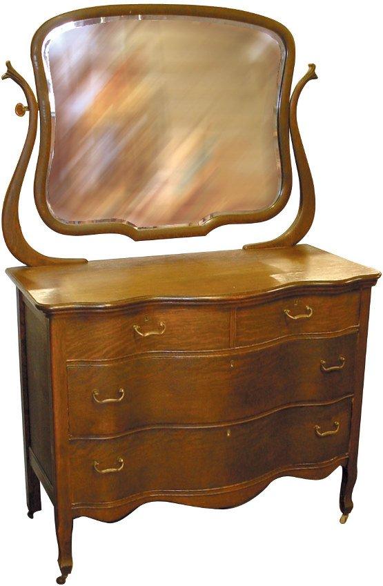 21: Oak dresser w/beveled wishbone mirror & serpentine