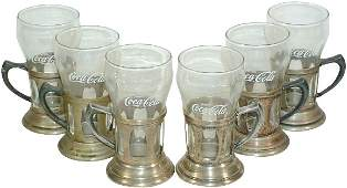 1201 Enjoy CocaCola glasses in old cutout metal holde