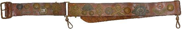 1365: Militaria, WW1 German hate belt, 17 cap badges &
