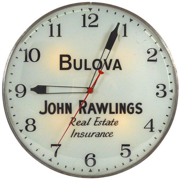 7: John Rawlings Real Estate & Insurance light-up clock