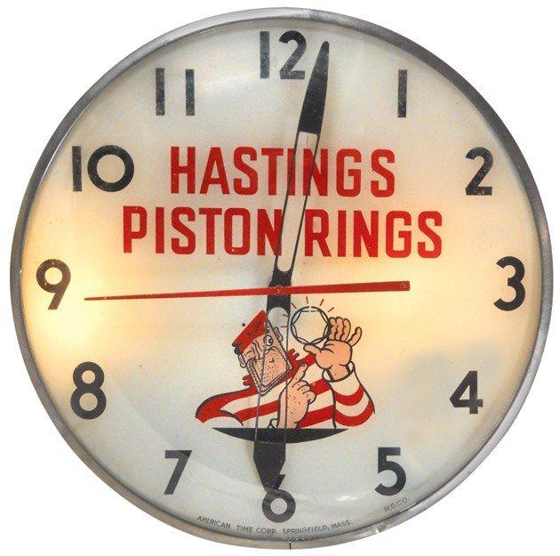 13: Hastings Piston Rings light-up clock, mfgd by Ameri