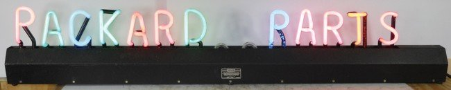 93: Packard Parts changeable neon letter sign, new old