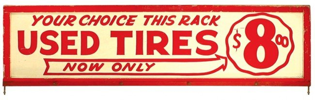 """94: Used Tires sign """"Your Choice This Rack Now Only $8."""