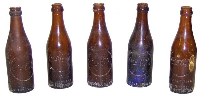 674: Coca-Cola soda pop bottles (5), amber embossed bot