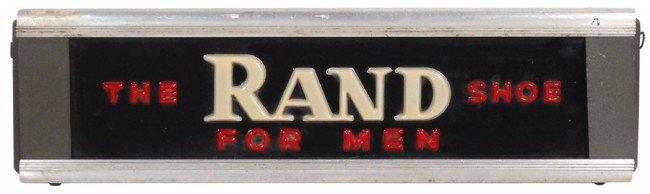 1128: Rand Shoes for Men light-up sign, embossed plasti