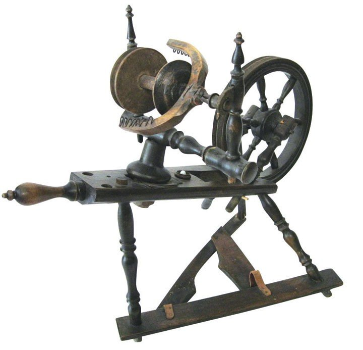 0022: Primitive spinning wheel, wood w/new leather on t