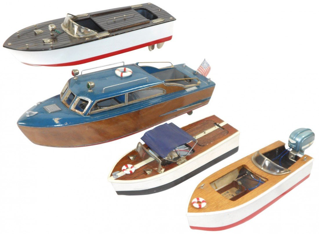 0658: Toy boats (4), all Fleet Line, 2 inboards, 1 outb