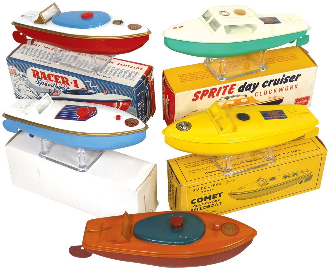 0858: Toy boats (5) & boxes, mfgd by Sutcliffe (England