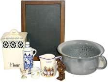 13: Gray granite ware bedpan, child's school slate, Ger