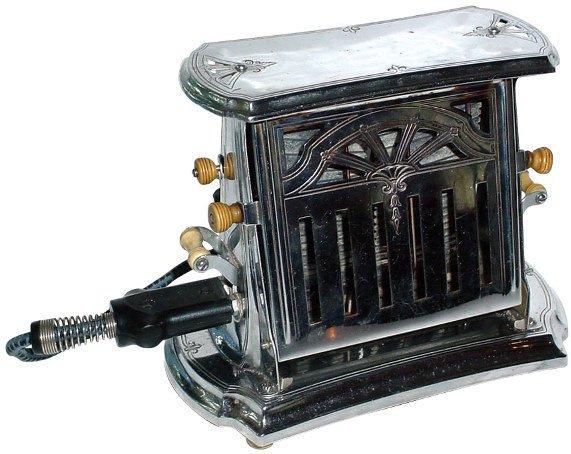 21: Universal E7712 chrome toaster w/Bakelite trim, Exc