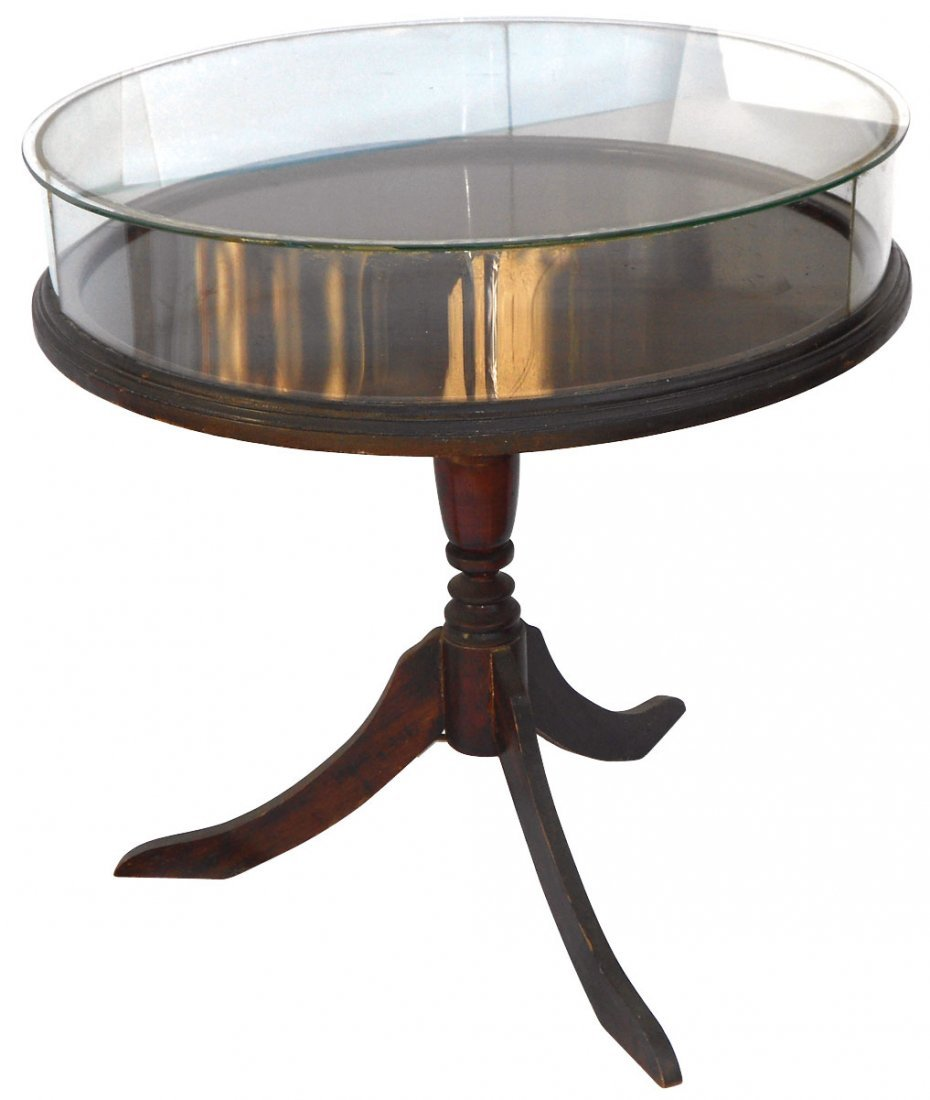 0164: Showcase table, round glass hinged top on 3-leg m