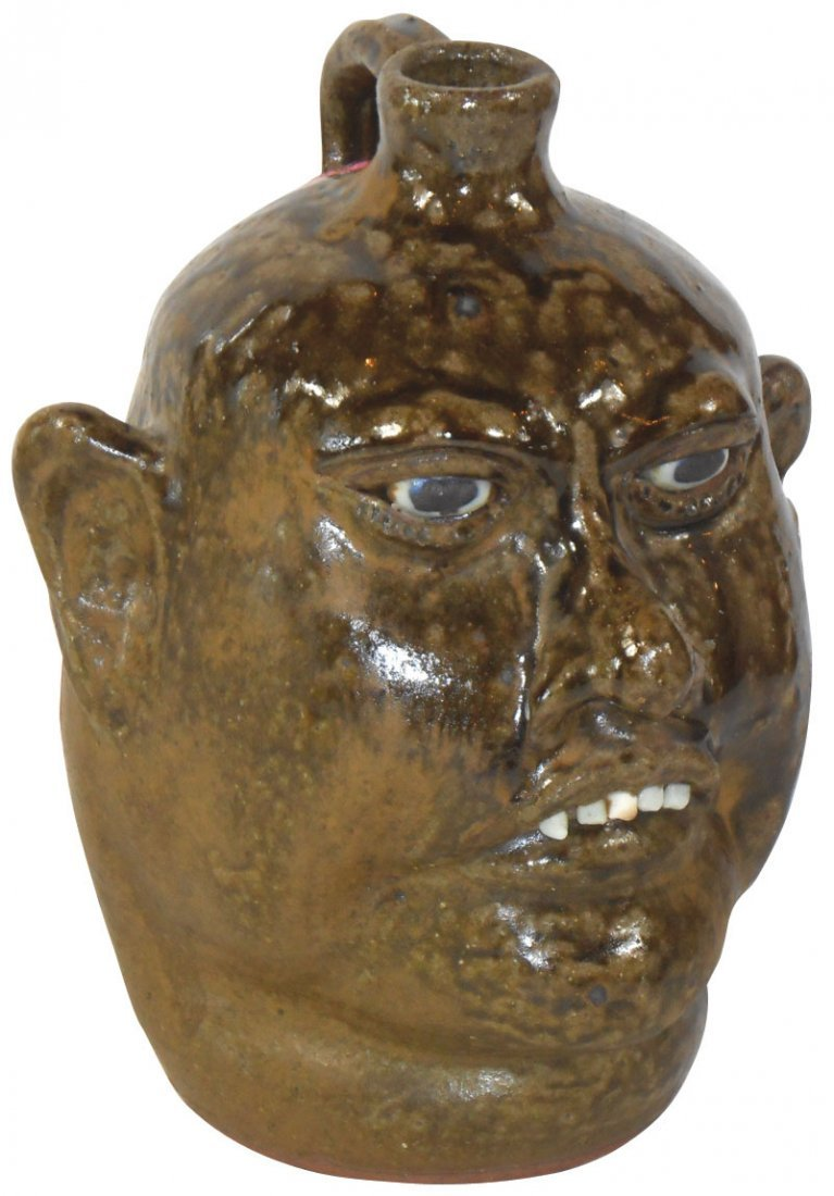 Meaders folk pottery face jug w/grotesque features,