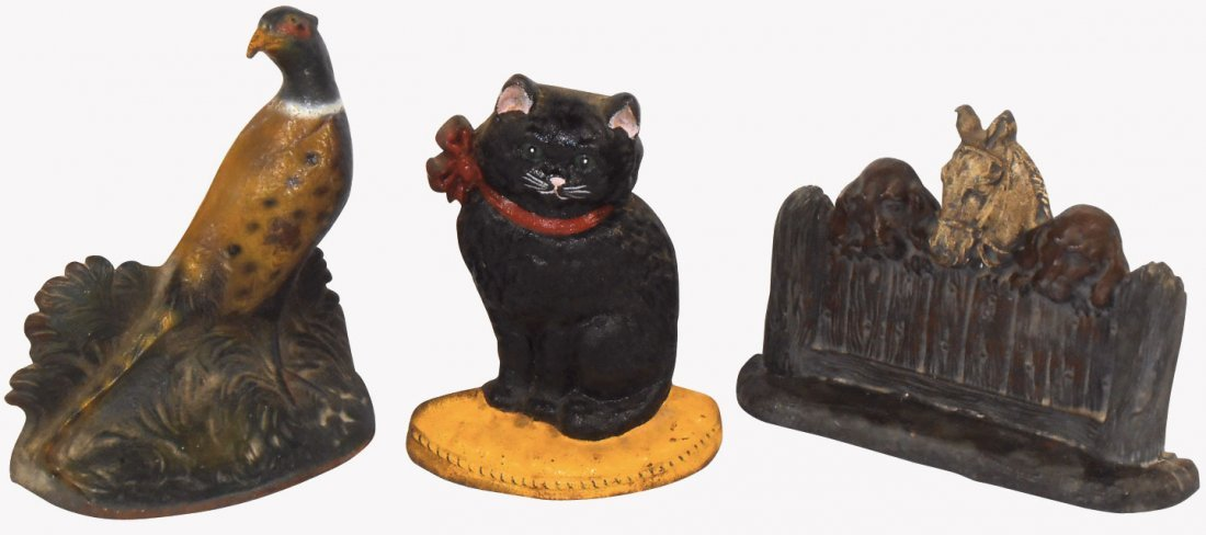 Cast iron door stops (3), horse w/dogs on fence,