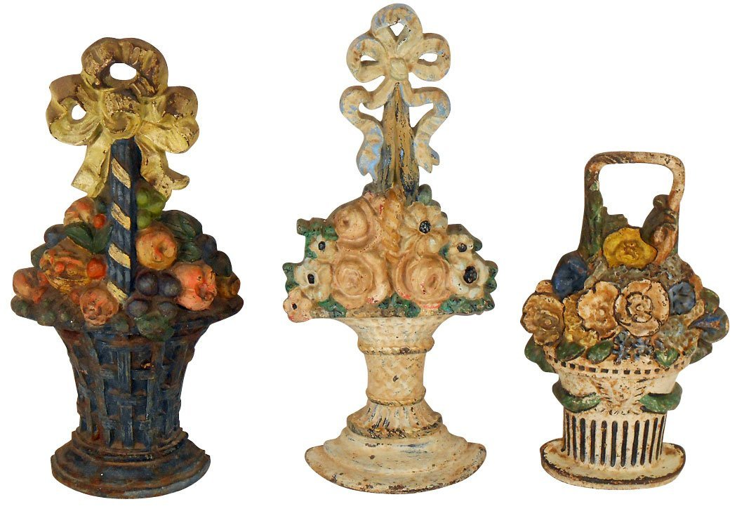 Doorstops (3), painted cast iron floral bouquets in