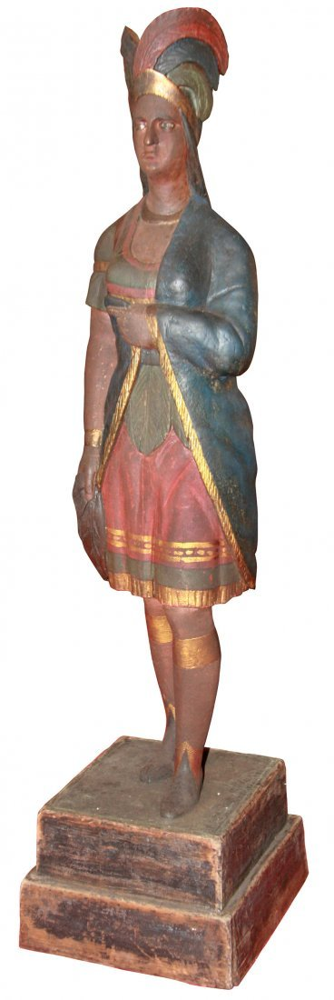 Cigar Store Indian Princess holding tobacco leaf, an