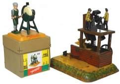 Toys (2), steam-powered, 2 men working on hammer mill,