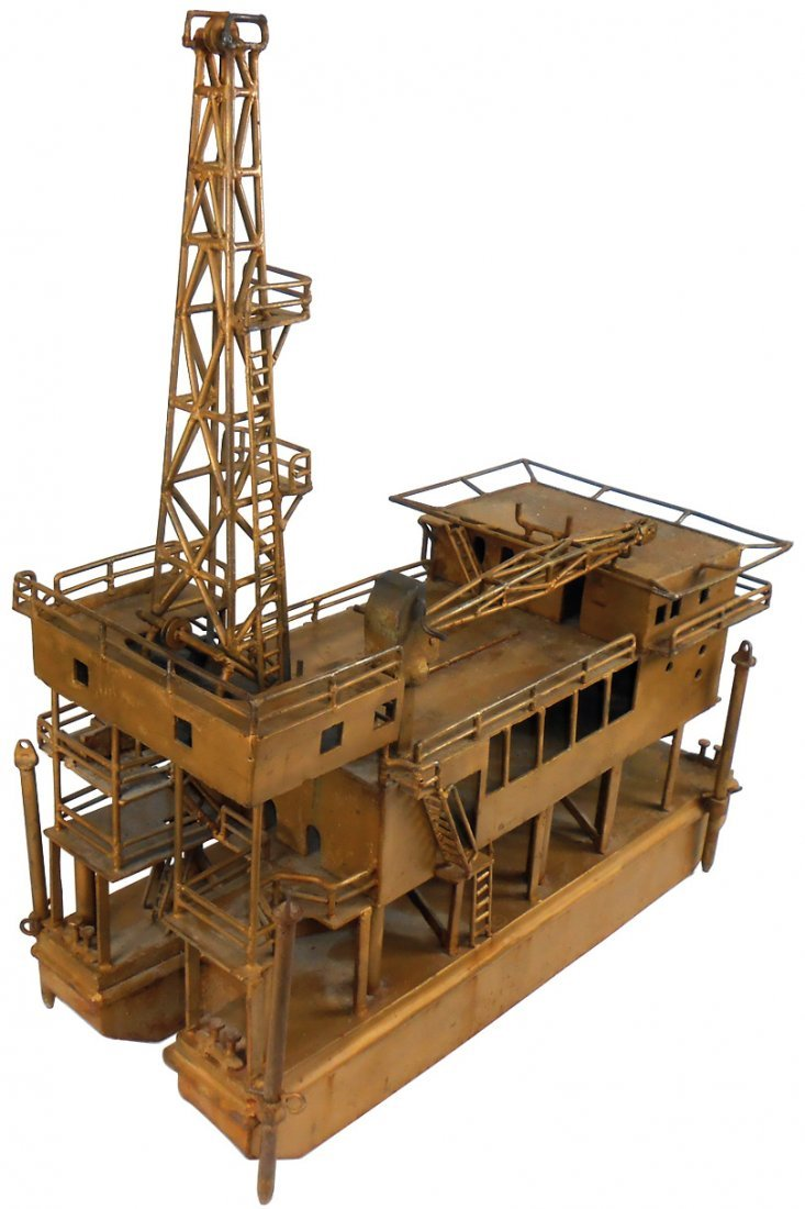 Toy floating oil well rig, a hand shaped & welded metal