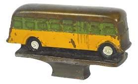 Mascot hood ornament, General Motors yellow coach,