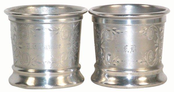 503: Barber shop shaving mugs (2); pair of chased alumi