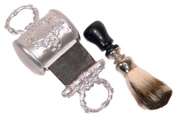 509: Barber shop razor strops (2); white metal (spelter