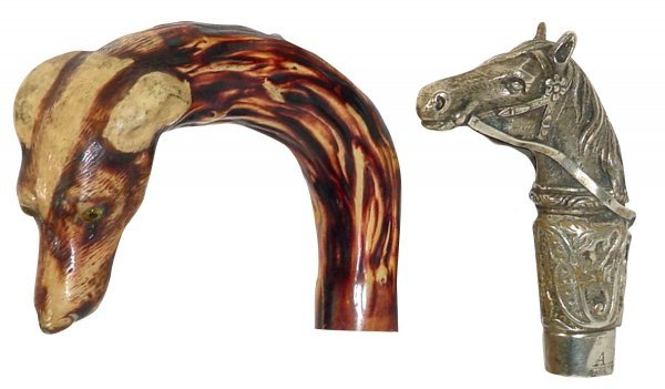 519: Cane & riding crop handles; cane handle has dog's