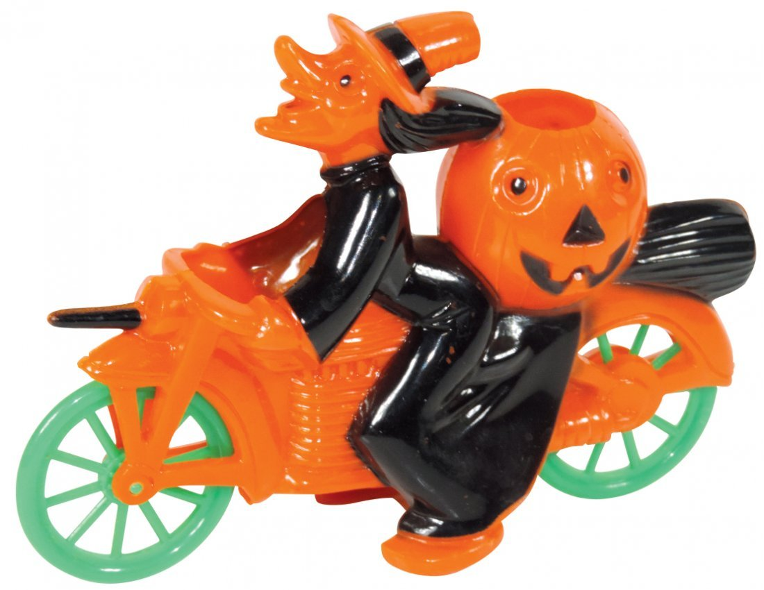 Halloween candy container, plastic witch on bicycle,