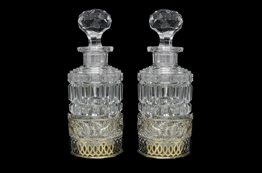 A PAIR OF CUT CRYSTAL BOTTLES AND STOPPERS