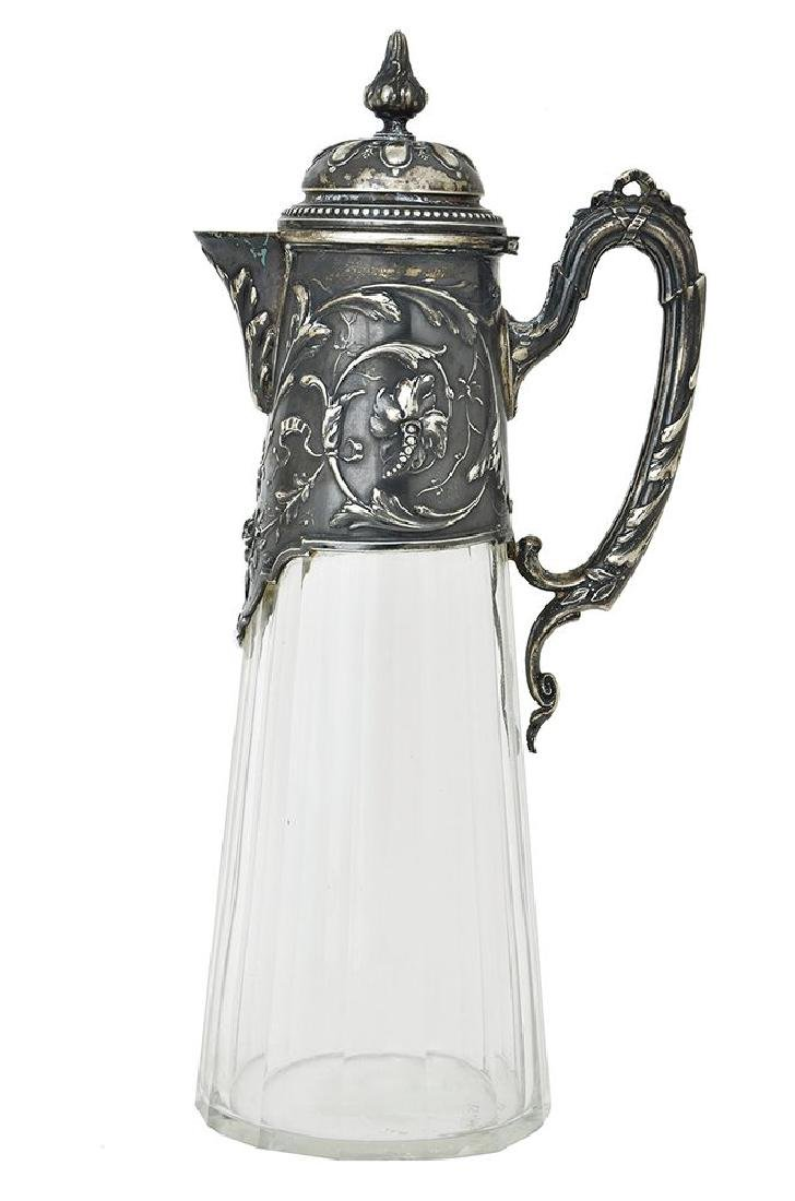A SILVER MOUNTED GLASS DECANTER