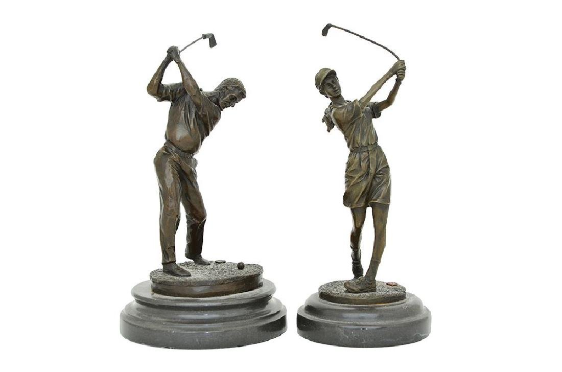 A PAIR OF BRONZE FIGURES OF A MALE AND FEMALE GOLFERS