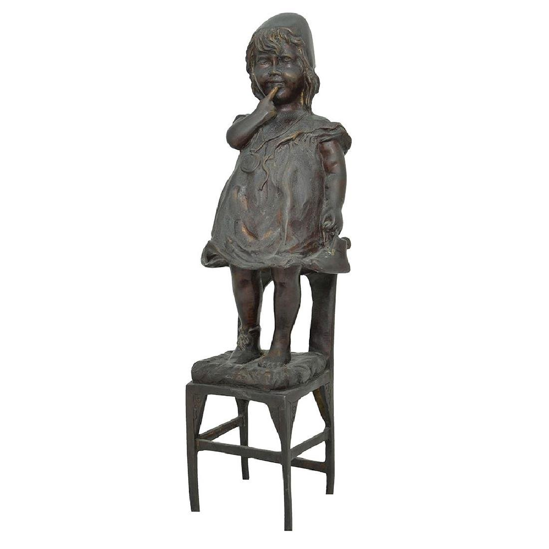 A BRONZE FIGURE OF A GIRL ON A CHAIR WITH HER SHOE IN