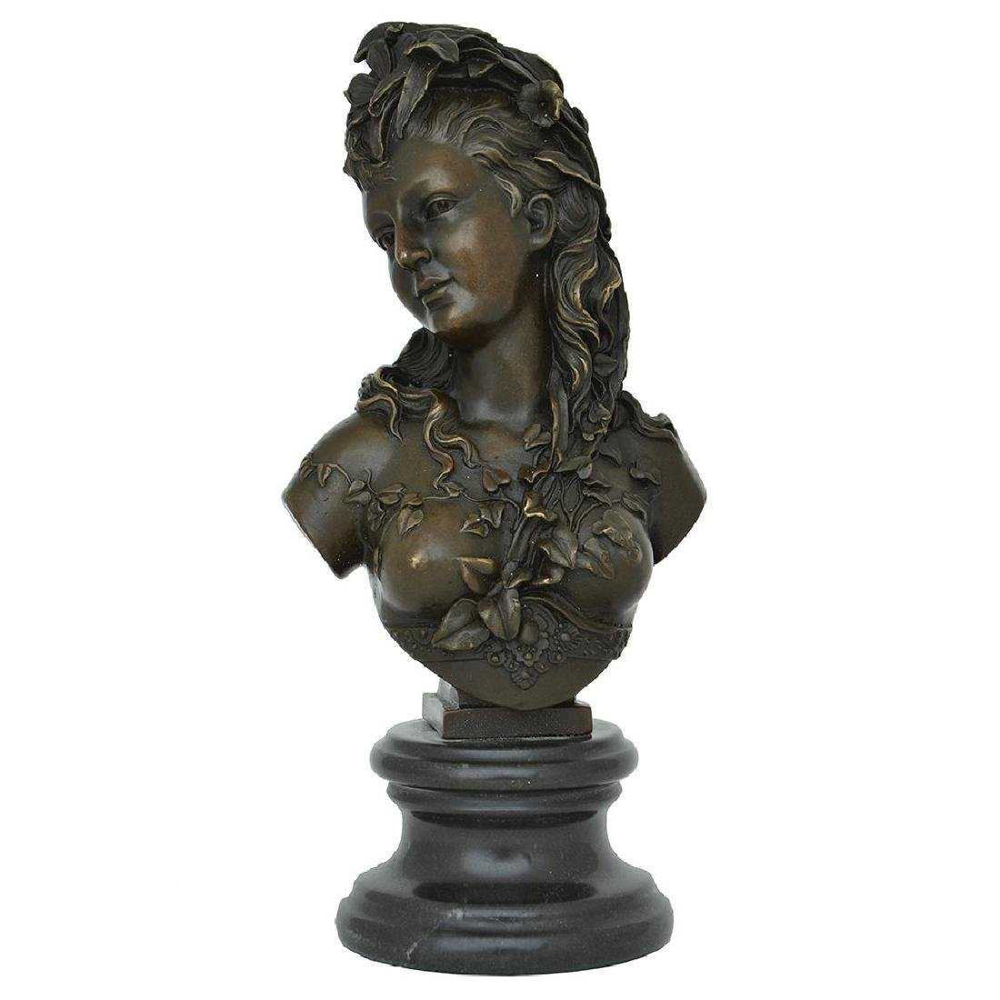 A FEMALE BRONZE SEMI-NUDE BUST ADORNED WITH IVY LEAVES