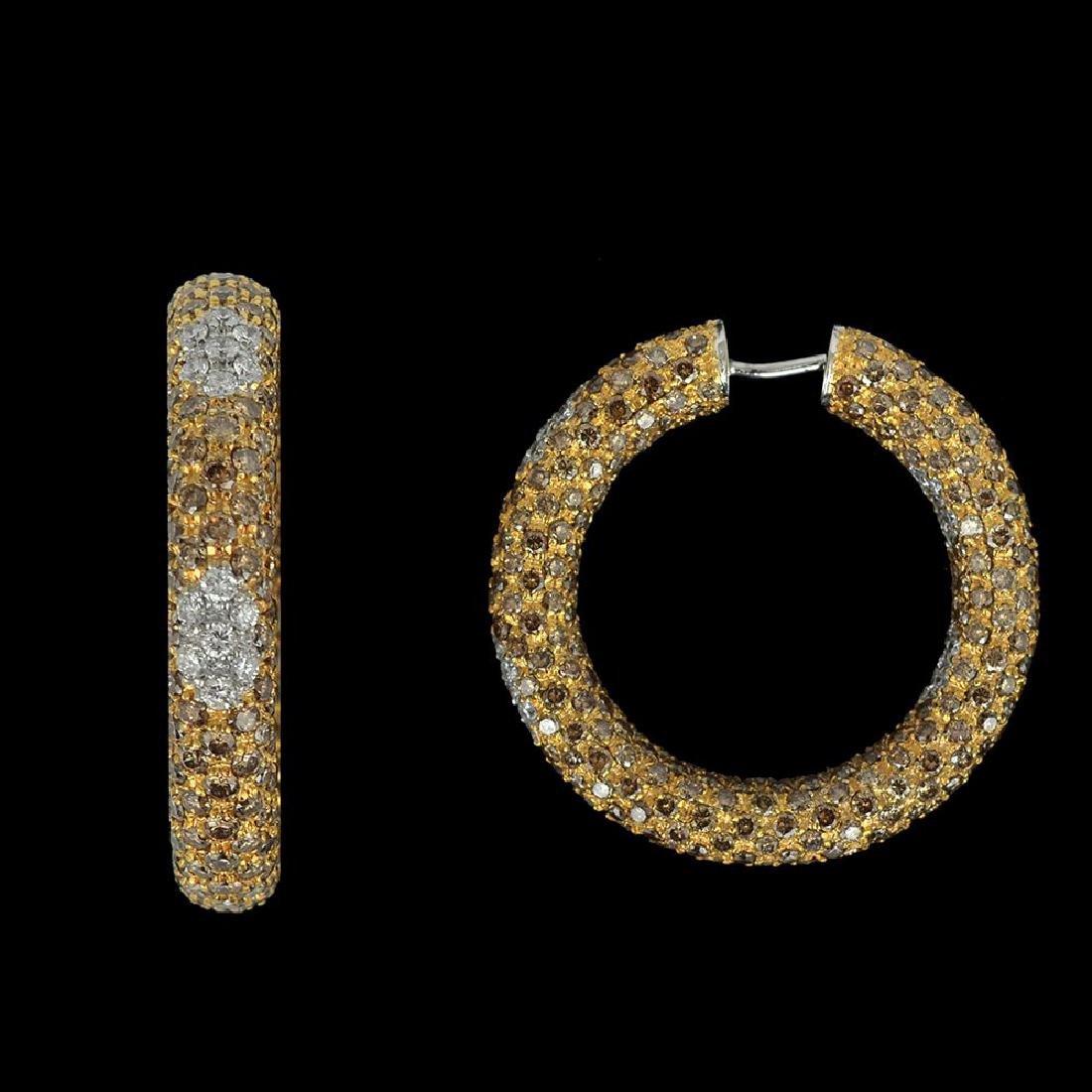 A PAIR OF 18K GOLD GYPSY EARRINGS