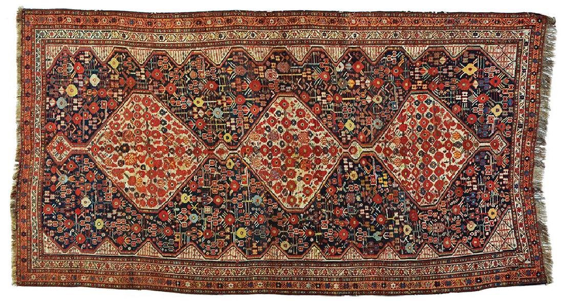AN ANTIQUE PERSIAN SHIRAZ RUG