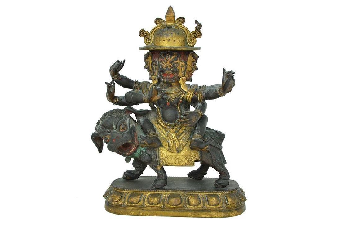 A TIBETAN PARCEL GILT BRONZE FIGURE OF A BUDDHIST DEITY
