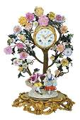 A FRENCH PORCELAIN AND BRONZE CLOCK