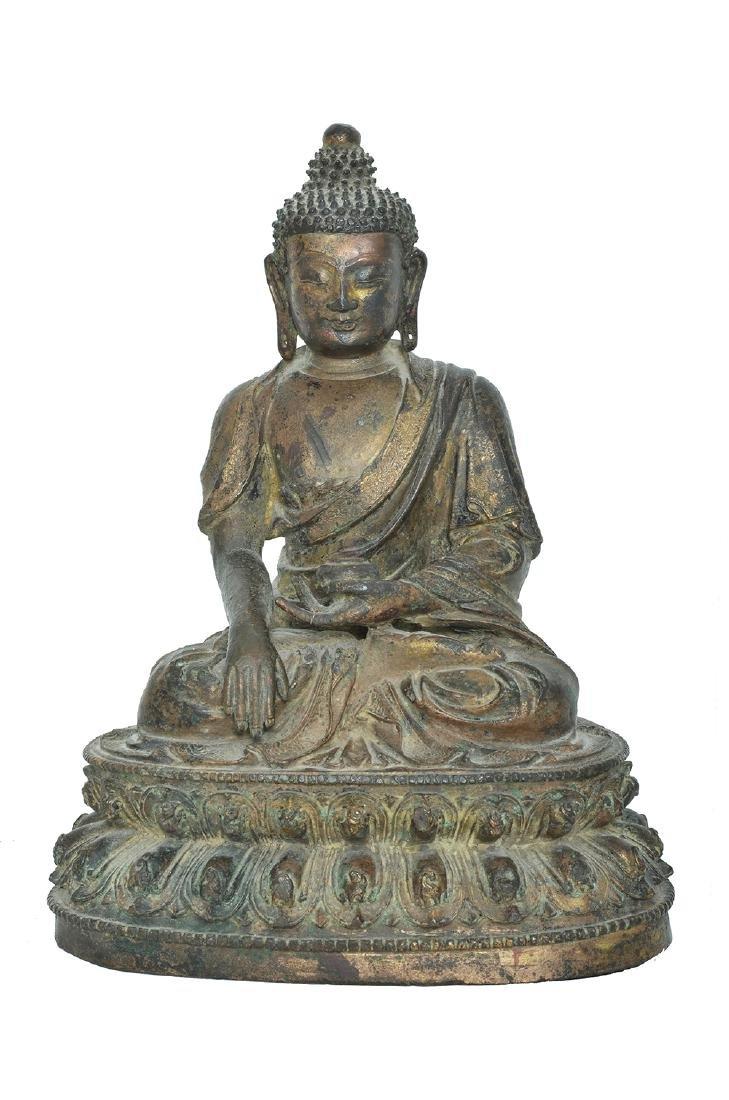 A CHINESE BRONZE FIGURE OF SHAKYAMUNI BUDDHA