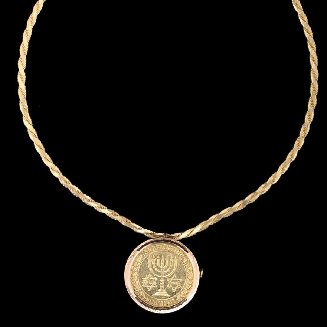 An 18K GOLD, 900 GOLD COIN PENTANT/BROOCH