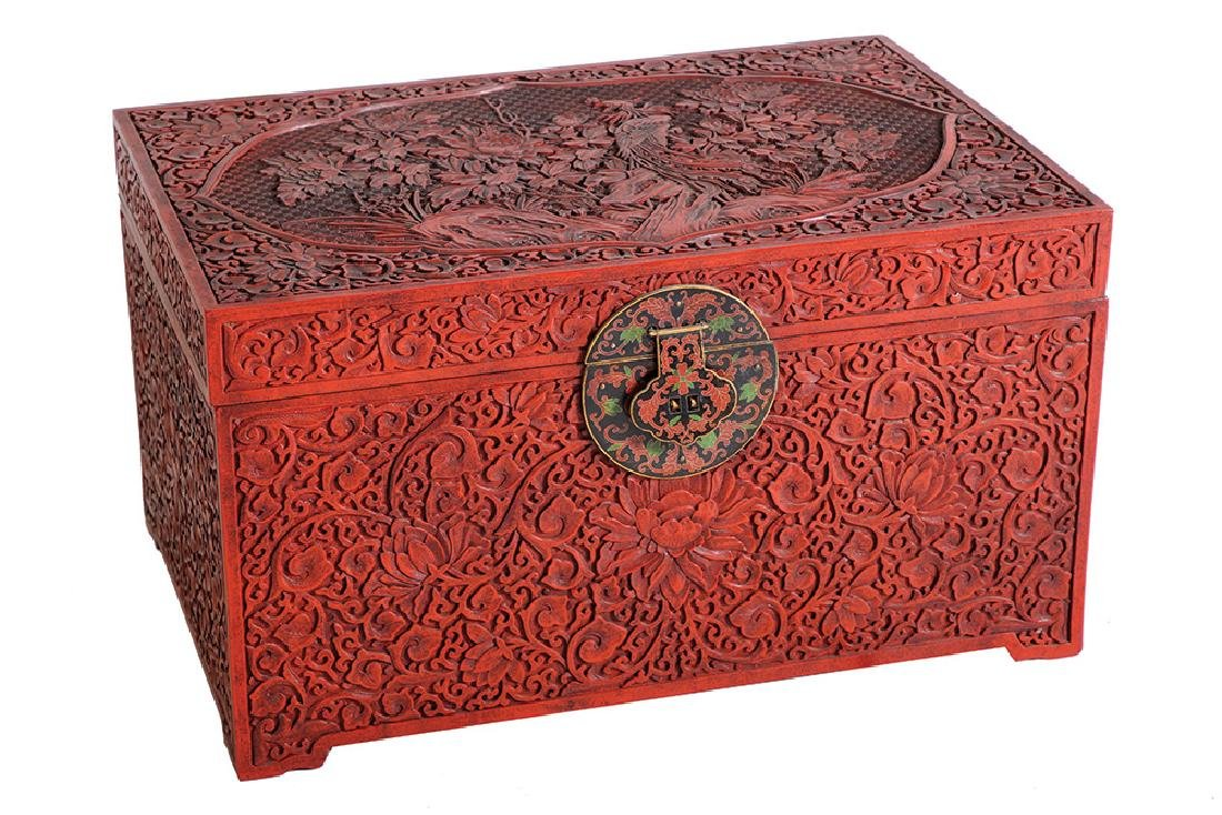 A CHINESE CINNABAR RED LACQUER CHEST