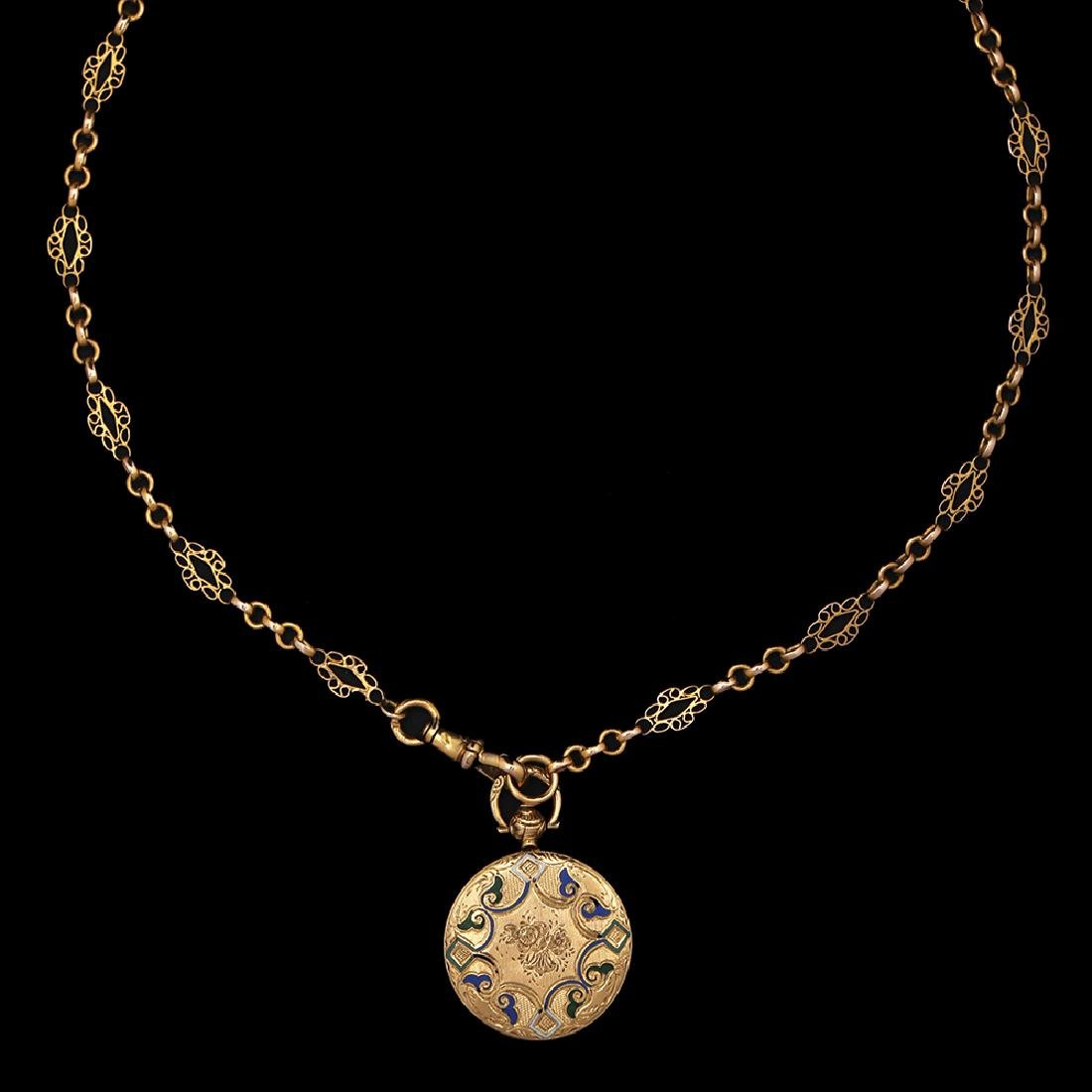 AN 18K GOLD PENDANT