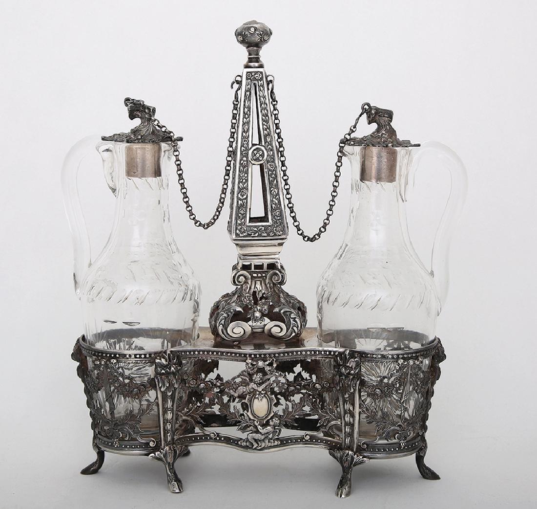 A SILVER AND GLASS CRUET SET