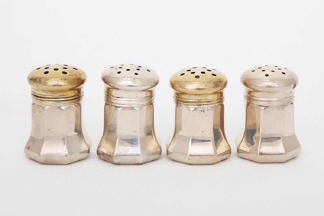 FOUR CARTIER STERLING SILVER SALTS AND PEPPERS
