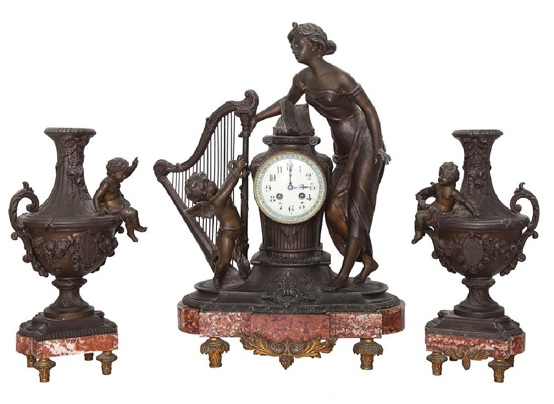 A FRENCH CLOCK AND PAIR OF PEWTER VASES