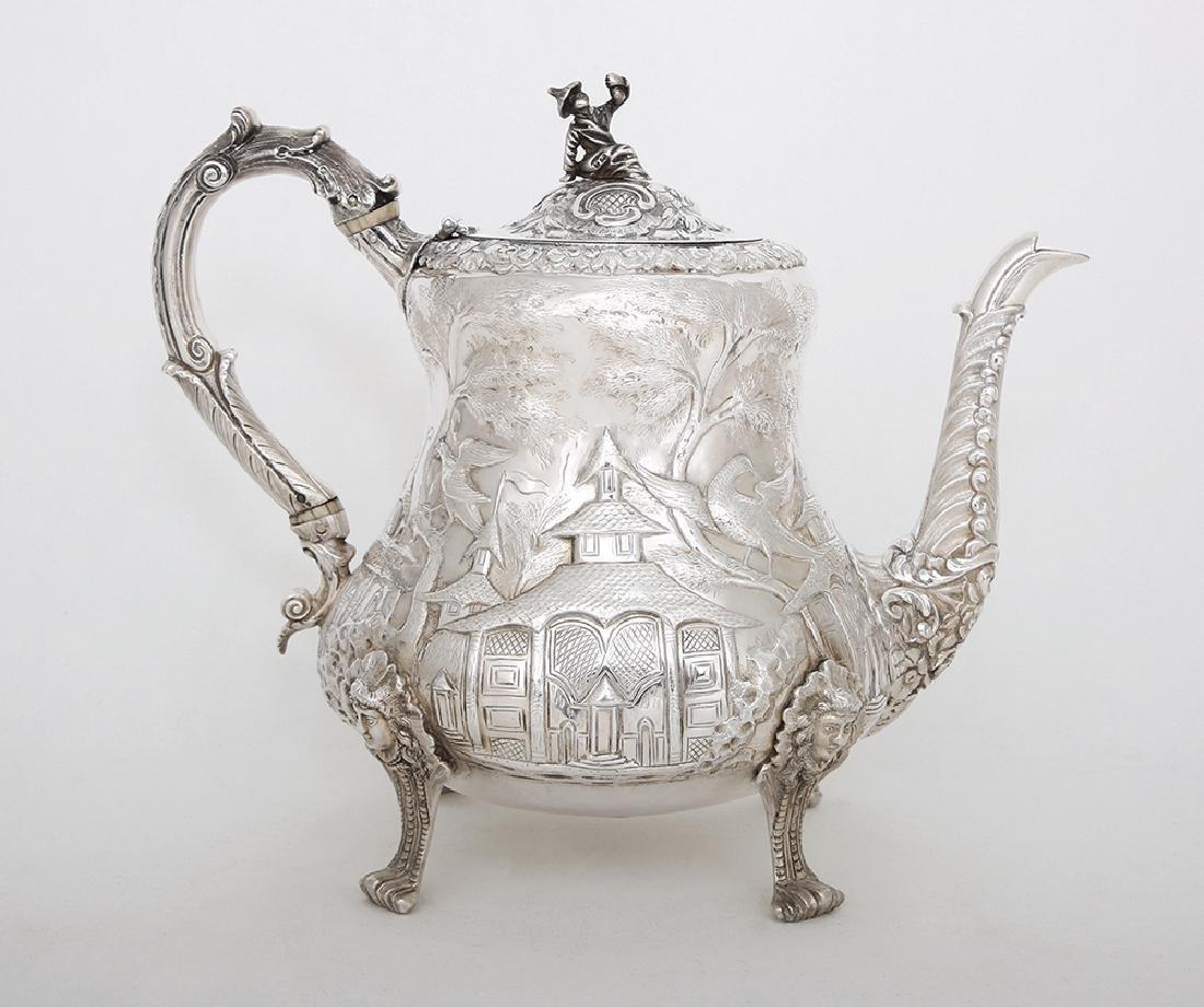 A GEORGE IV SILVER CHINOISERIE TEA POT