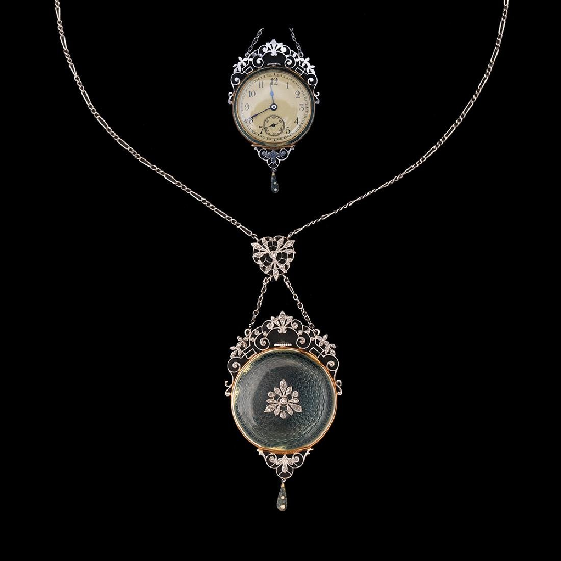 AN 18K GOLD AND PLATINUM PENDANT/POCKETWATCH