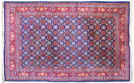AN OLD PERSIAN VARAMIN CARPET