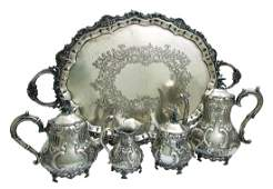 A STERLING SILVER FIVE PIECE COFFEE AND TEA SET