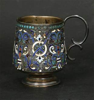 A SMALL RUSSIAN SILVER AND ENAMEL CUP WITH HANDLE
